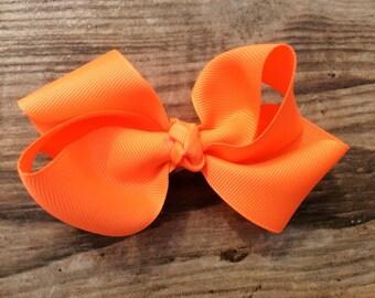 Orange boutique bow
