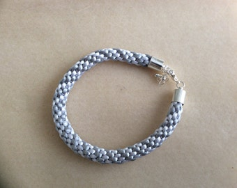 White and grey kumihimo bracelet