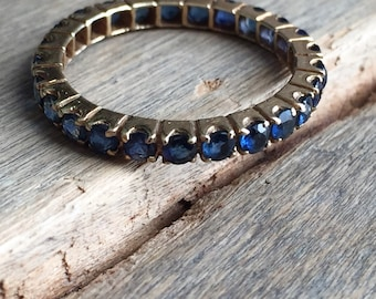 Sapphire eternity band 14K yellow gold