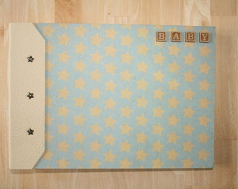 A4 large, handmade 'inside-out' album baby book, cream leather spine, blue with cream stars, with box
