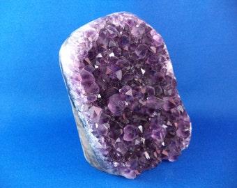 Medium Beautiful Deep Purple A Grade Amethyst Geode from Uruguay. Weighs 2 Pounds .04 Ounces.