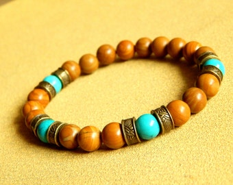 Bracelet of natural stone in beige color and antique ethnic style bronze