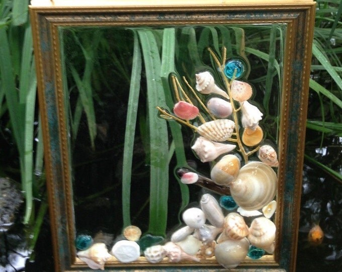 Teal Seashell Dreams, Framed Suncatcher with Welks, Olives, Scallops, Coral and Bead Accents Exclusive Home Decor at Crafts by the Sea