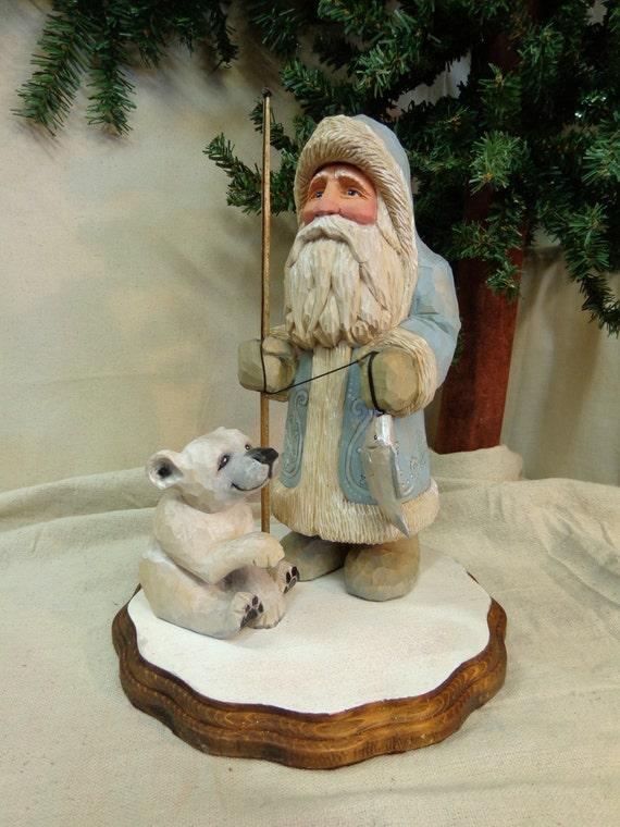 Hand carved wood arctic blue santa sculpture with polar bear