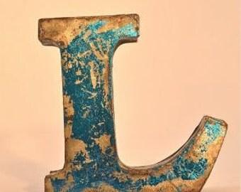 A fantastic vintage style metal 3D blue letter L