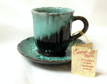 Evangeline Ware Cup and Saucer by Canuck Pottery (Quebec) Ltd Canada, finest handcraft pottery, item no. 1005, Green Glaze, Red Clay