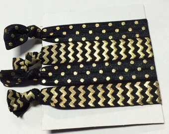 Set of four black and gold elastic hair ties