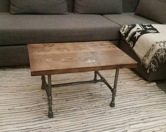 Rustic industrial pipe and wood coffee table