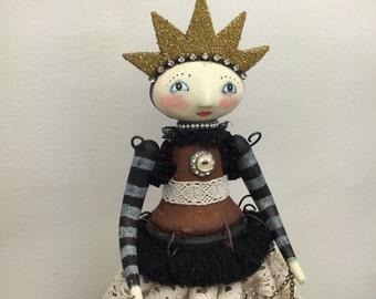 A mixed media art doll