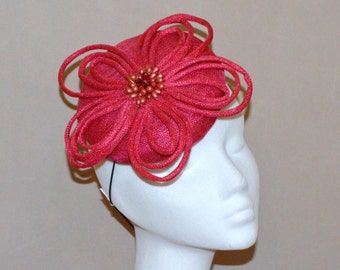 Pink sinamay hat with trim