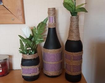 Set of 3 black twine wrapped bottles/vases