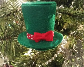 Kelly green felt top hat ornament with red and white polka dot ribbon and red bow