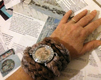 crochet wrist warmer with mud-colored clock
