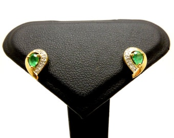 Amazing 18 Carat Gold Emerald Diamond Stud Earrings.