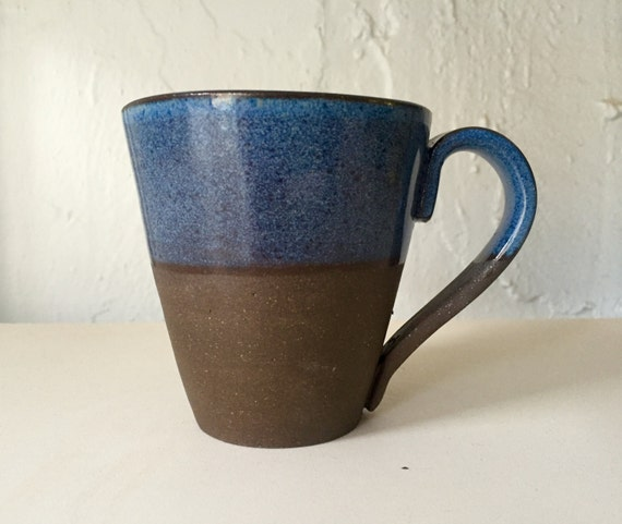 Ceramic modern black clay coffee mug in blue.