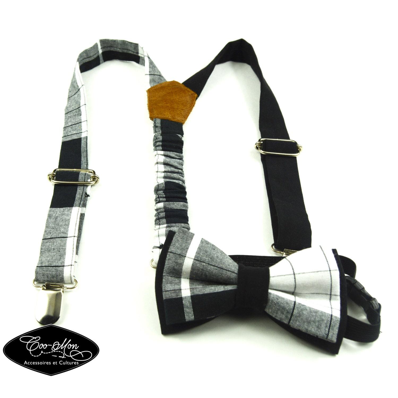 White shirt black tie suspenders