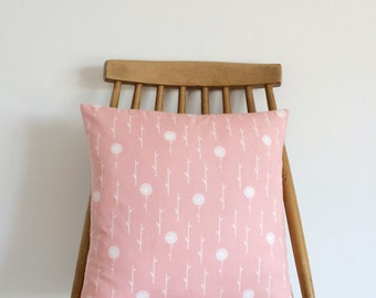 Peachy pink cushion with simple flowers. Feather insert included.