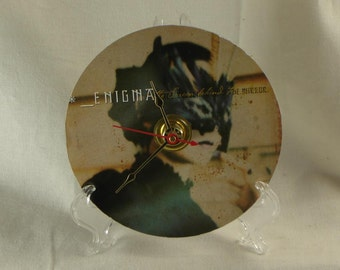 Enigma Cd Clock - 4 1/2 inch Diameter Desk Or Wall Mount Clock - Clear Acrylic Stand and AA Battery Included - Ships boxed within a box.