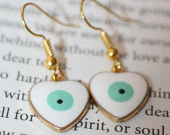 Ceramic all seeing / Evil eye earrings in gold and turquoise tones. Stunning eye catching earrings. look amazing on.