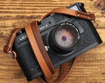 Thick Brown Leather Camera Strap for the Minimalist Shooter with Linen Stitching.