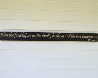 Bless the food before us, the family beside us and the love between us.  Amen  --Wood sign, stained and painted