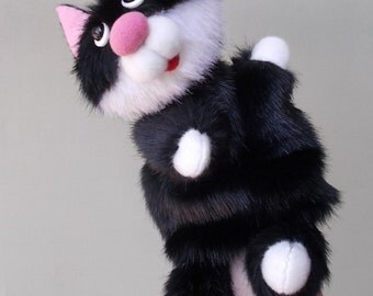 Big black cat. Bibabo. Toy glove. Puppet theatre. Marionette. Toy on hand.