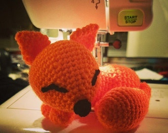 Little crocheted amigurumi, crochet handmade toy, fox, foxy