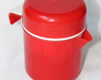 Press citrus red plastic pitcher