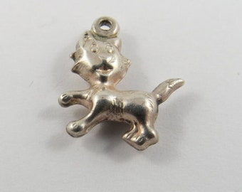 A Kitty Cat with Head Turned  Sterling Silver Charm or Pendant.