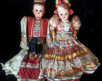 Rare Antique Pair of Composition & Cloth Hungarian Dolls From The Mid 1800's. Dressed In Traditional Matyo Folk Attire For A Married Couple.