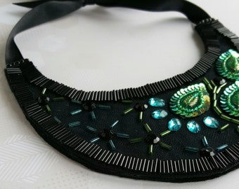 Statement necklace beaded in peacock colours blues, greens and golds