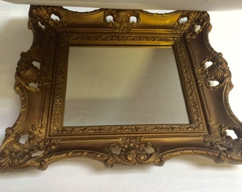 Vintage 1960s Ornate Gold Plastic Baroque Frame Wall Hanging Mirror