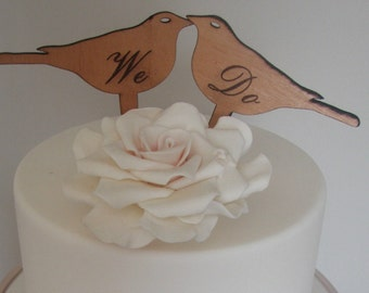 Timber love bird cake toppers with engraved message 'We Do'