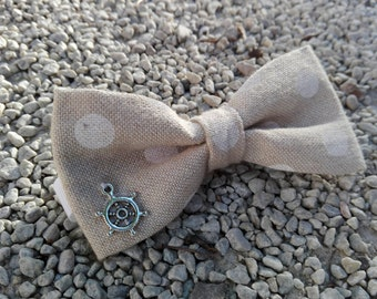 Beige cotton polka dot with bow-shaped accessory tiller