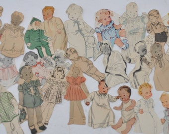 Over 30 very old vintage handcut paper dolls of infants, babies, and toddlers.