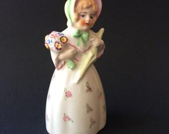 Porcelain girl bell
