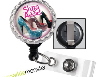 Shoe Addict - black ID badge reel with silver bottle cap, high heels, cute quote