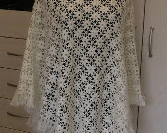 White crocheted poncho