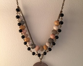 Handmade, layered, beaded, yellow toned, short necklace.