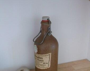 bottle of calvados in sandstone