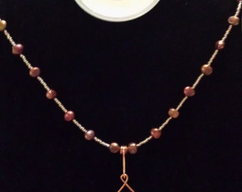 Copper colored freshwater pearl necklace with copper wire focal and clasp