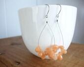 Juicy, peachy- gorgeous faceted glass teardrop hoops