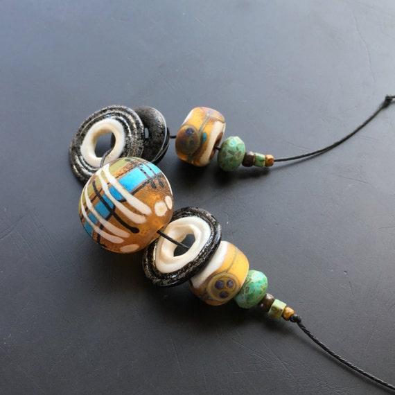 Lampwork glass bead set handmade by Lori Lochner rustic tribal trade beads boho jewelry and textile design artisan supplies