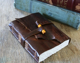 Leather Journal . Handmade Handbound . dark brown with handmade ceramic yellow peg (320 pgs)