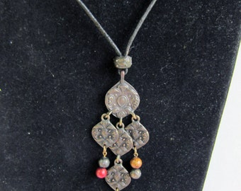 Textured metal and beaded Middle Eastern Look Pendant on Leather Cord