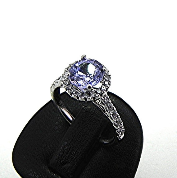Natural Light blue Sapphire   1.05mm  1.24 Carats   in 14K white gold Halo ring with .30 carats of diamonds 1515