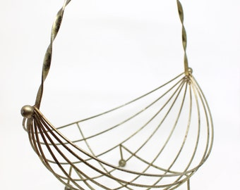 Mid century modern brass metal basket . Fruit or Easter egg basket . lovely shabby chic . 1950s 1960s farm or bicycle style