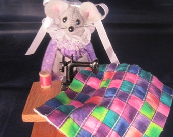 Quilting Mouse at a Sewing Machine