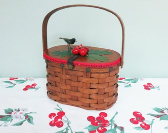 Vintage Woven Basket Handbag with Red Cherries, Millinery Leaves, Red Loop Braid Trim, a Tiny Black Bird, Wooden Top and a Bent Oak Handle