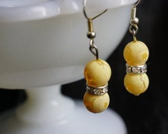 Beige drop earrings with crystal spacer